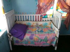 Baby crib turns into a toddler bed...comes with mattress/bumpers