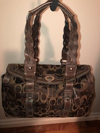 Authentic Coach purse. Chocolate brown signature logo material with leather trim. Excellent condition