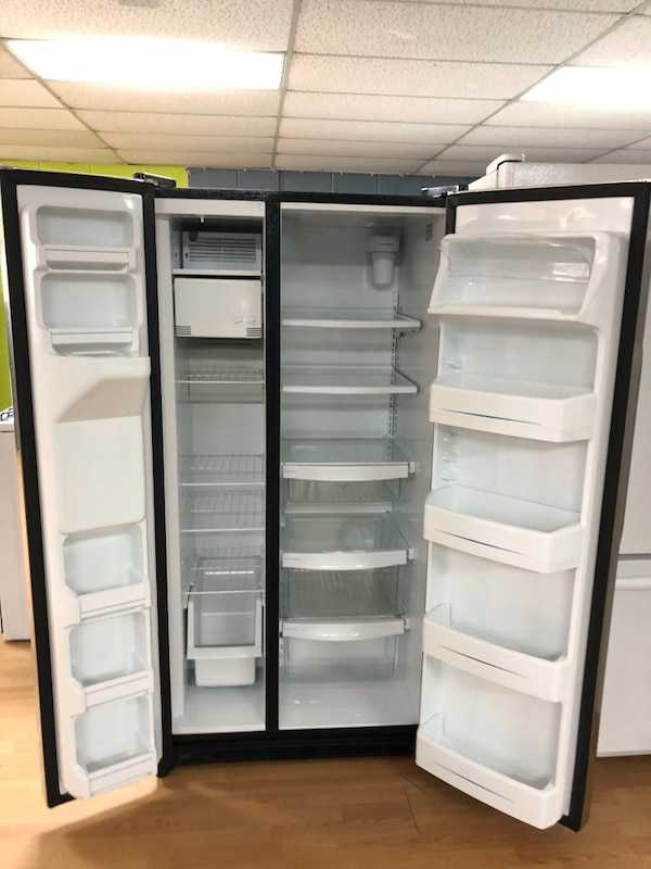 GE stainless steel side by side refrigerator  7f7f7a1a-7d67-4030-8815-7161dc6be8c7
