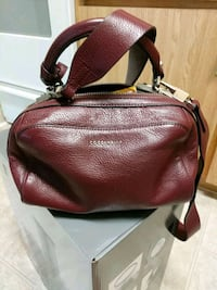 coccinelle women's handbag in very condition.  Coquitlam, V3J 1X4