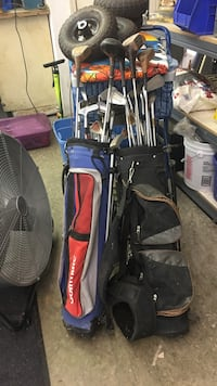 Black and red golf bag with clubs Saint Leonard, 20685