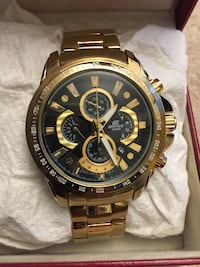 round gold-colored chronograph watch with link bracelet Maple Ridge, V2X 1B3