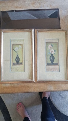 white magnolias and white orchids in vase two paintings with brown wooden frames