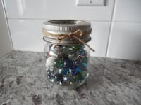 "Small 4.5"" Dominion Gem with Glass lid filled with Vintage Marbles. Great for decoration purposes or the marbles are still great to play with $10 PU Morinville Morinville"