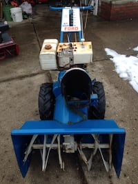 blue and black Ford snow thrower