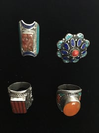 four silver-colored and assorted-color stone rings