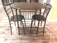 Round brown wooden table with two chairs Brampton, L6V 3S3