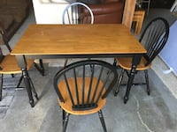 rectangular brown wooden table with four chairs dining set Calgary, T3E 6X1