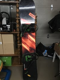 black and red snowboard with bindings 795 km