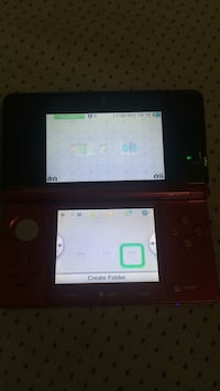 black Nintendo 3DS with game cartridge 3153 km