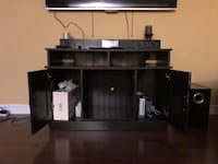Black wooden tv stand, not including anything on it 550 km