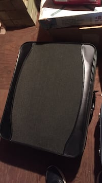Dark colored suitcase