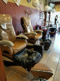 two brown and black leg massager chairs West Covina, 91792