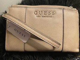 Brand new GUESS clutch and  wallet(negotiable )