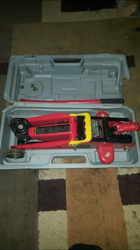 red and black power tool in case Chesapeake