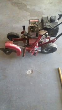 red and black push mower Lancaster, 93534