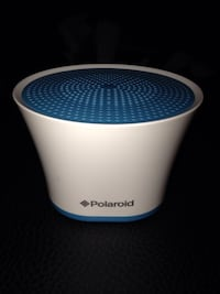 blue and white polaroid speaker