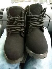pair of black leather work boots 1179 mi