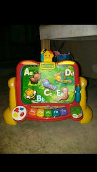 baby's green and red learning walker El Paso, 79934