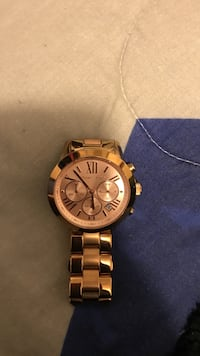 Women's round rose gold Michael Kors chronograph watch with link bracelet