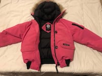 red and black zip-up jacket 512 km