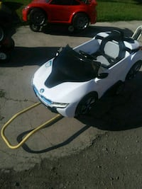 white and black motor scooter 1495 mi