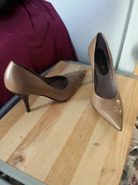 pair of beige leather pointed-tip stilettos