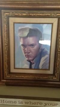 man in blue suit painting with brown wooden frame Lubbock, 79415
