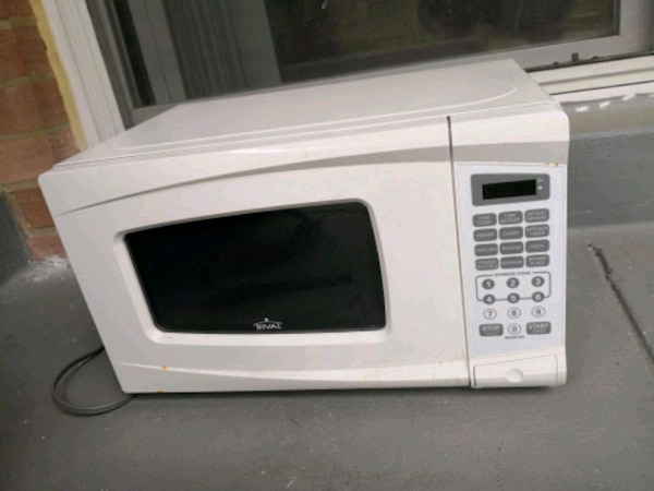 white GE over-the-range microwave oven
