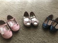 Three pairs of shoes for a girl