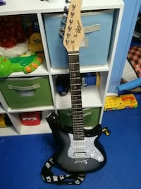 white and black electric guitar Northfield, 44067