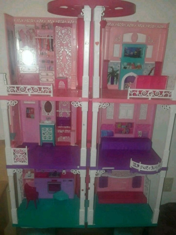 Used Pink And White Wooden Dollhouse For Sale In Hurst Letgo