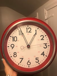 Red wall clock very good condition Arlington