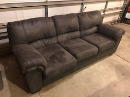 Gray couch and loveseat