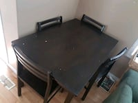 rectangular black wooden table with four chairs di Edmonton, T5L 1A8