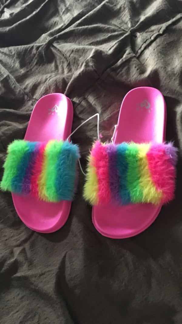 Pair of pink-and-blue slide sandals a51770e6-19d7-42a6-a2cb-ad638cebbd70