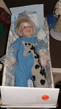 baby wearing blue and gray giraffe graphic footie pajama doll with box Forest Hill, 21050