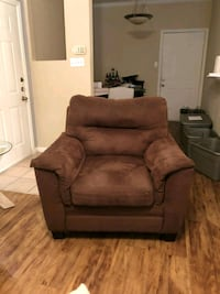 brown fabric sofa chair with throw pillow