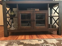 brown wooden TV hutch with flat screen television Fort Hood, 76544