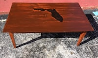 Brown wooden coffee table with florida map print