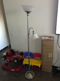 stainless steel and white floor lamp