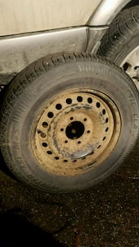 gray bullet hole car wheel with tire Kelowna, V1P 1J1