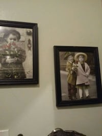 two brown wooden framed paintings 2274 mi