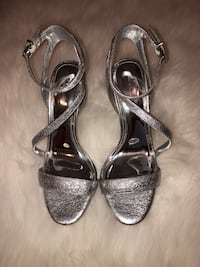 Pair of silver  leather open toe ankle strap heels San Antonio, 78245