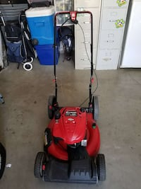 red and black push lawnmower