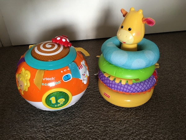 orange and teal vtech round toy and fisher price stacker