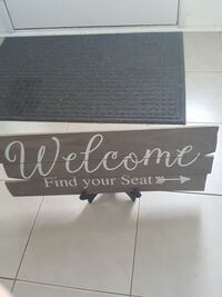 gray and white welcome printed wooden decor