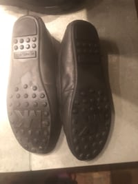 pair of black leather slip-on shoes Surrey
