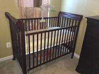 baby's brown wooden crib with mattress Broadlands, 20148