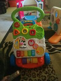 baby's multi color Vtech activity walker Swansea